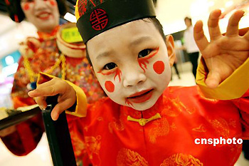 A child wears scary costumes to celebrate the forthcoming Halloween Festival in Hong Kong on Tuesday, Oct. 24, 2006. Halloween is celebrated on the night of Oct. 31.